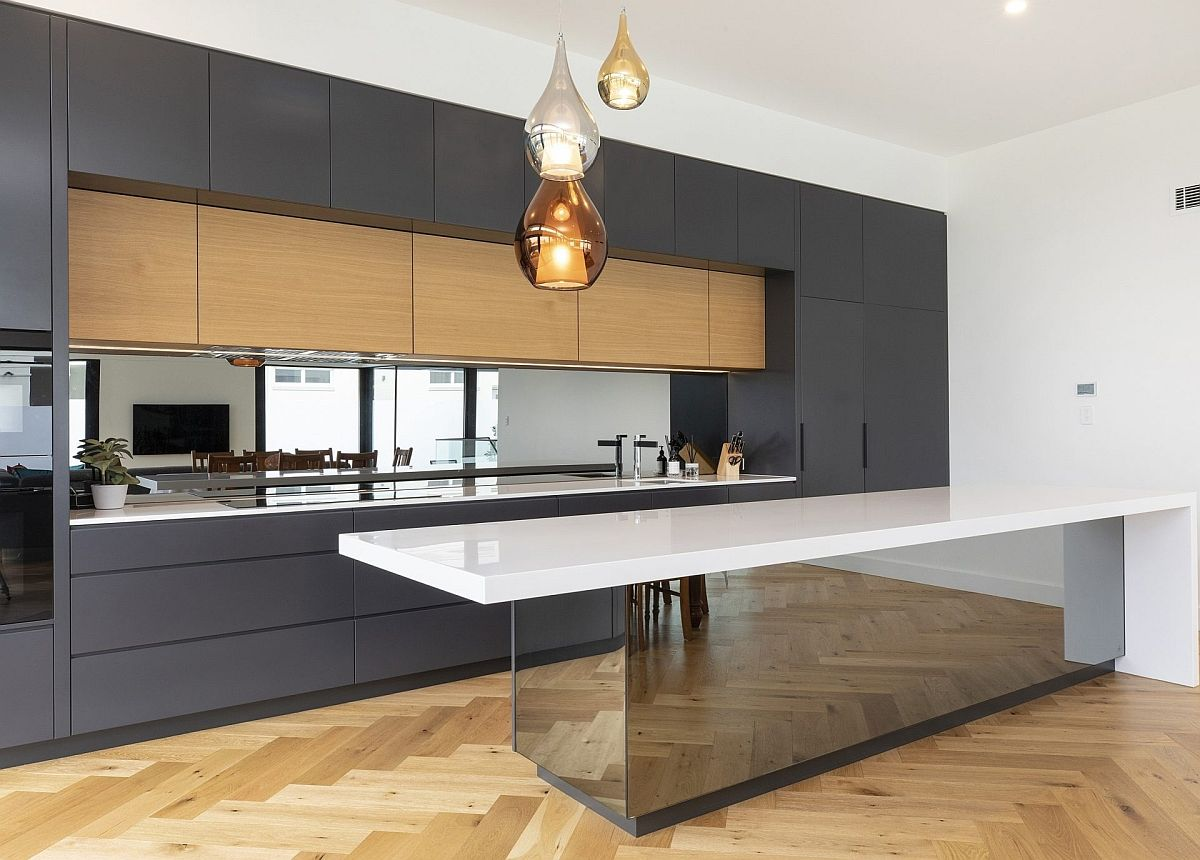Reflective beauty of the mirrored kitchen island let it stand out viusally pretty much in any kitchen it adorns