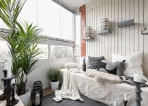 Relaxing-sunroom-of-Gothenburg-apartment-in-white-and-gray-epitomizes-modern-Scandinavian-style-13594-217x155