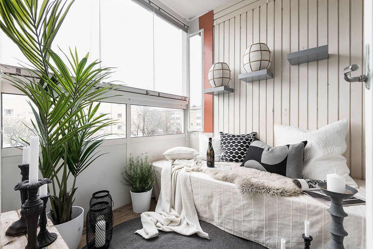 Relaxing sunroom of Gothenburg apartment in white and gray epitomizes modern Scandinavian style