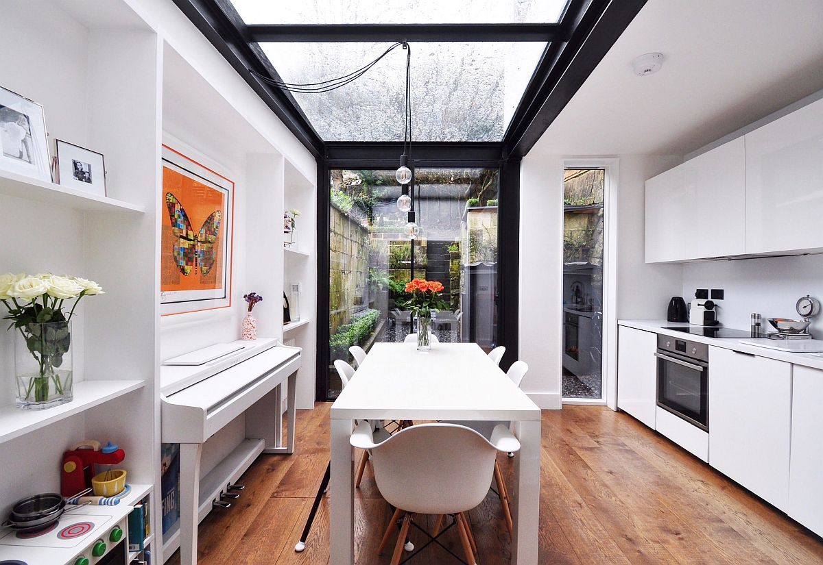 Roof lights and floor-to-ceiling glass walls are the perfect way to bring the outdoors inside