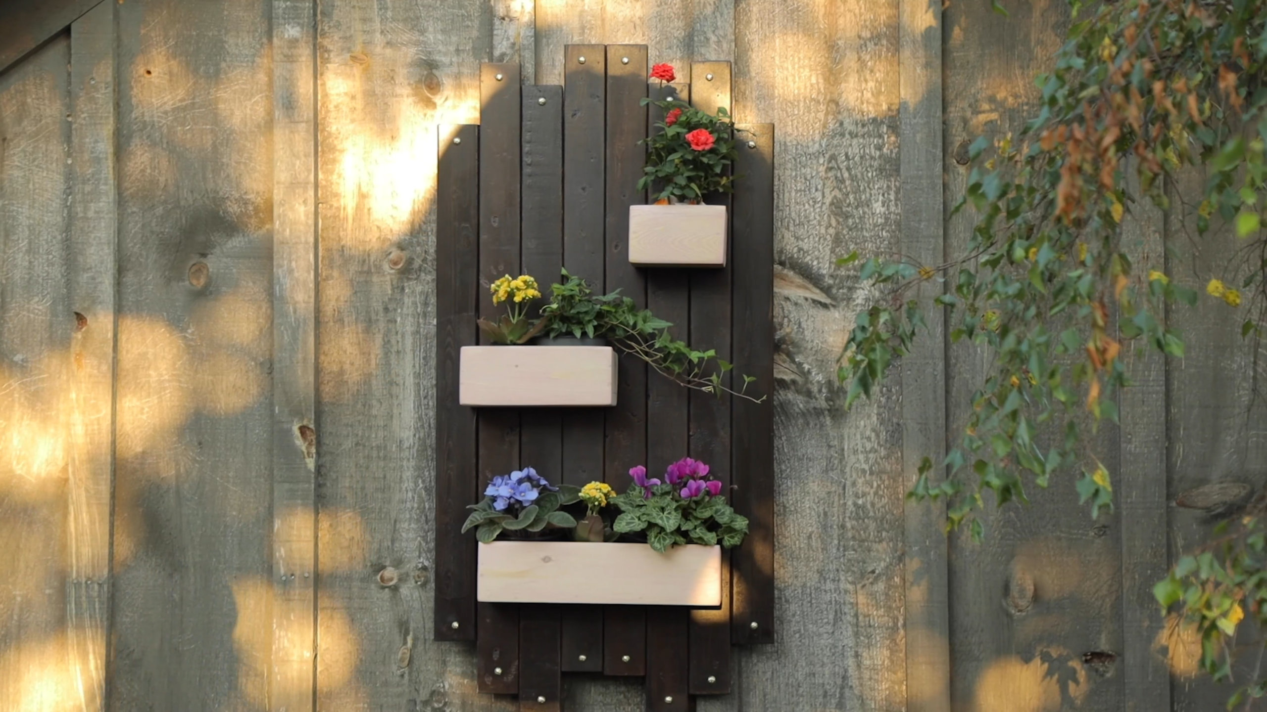 Hanging wood planter adds gorgeous vintage feel