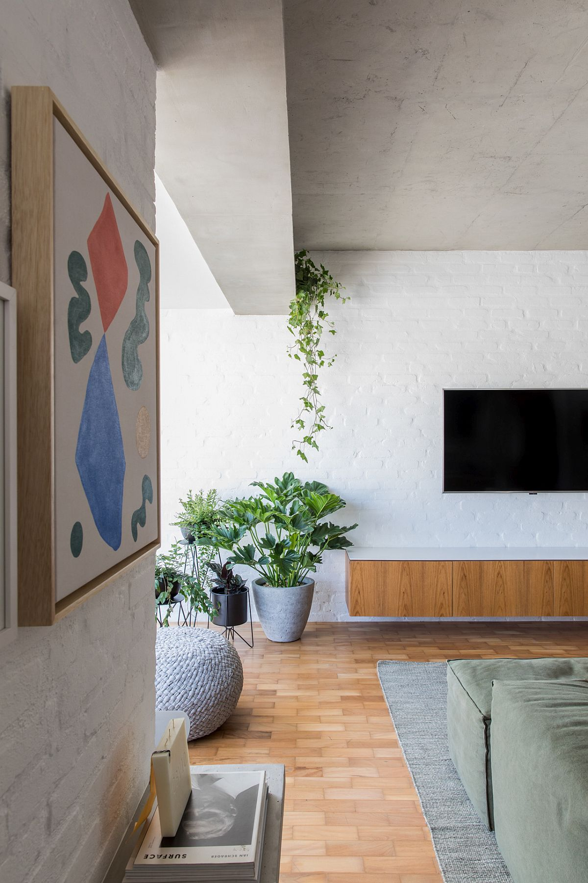 Select wall art pieces add color to the neutral interior in white, wood and gray
