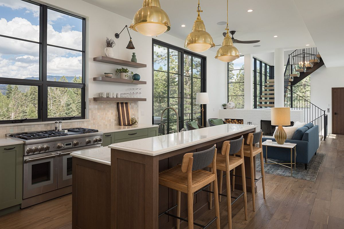 Series of fabulous windows and doors connect this mdoern kitchen with the outdoors