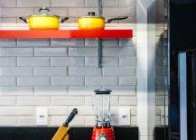 Sleek-floating-shelves-in-orange-add-color-to-the-white-tiled-kitchen-backsplash-46425-217x155