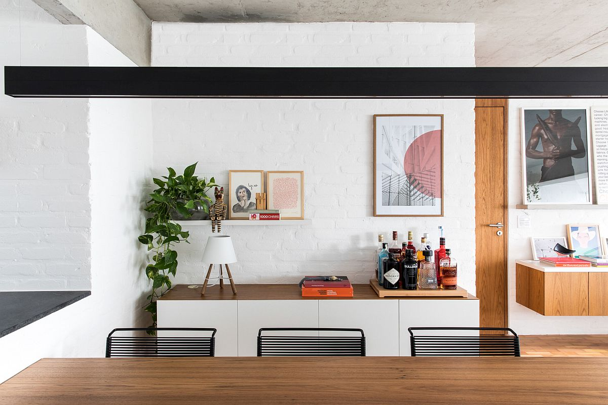 Slim and stylish buffet in the modern dining room also serves as a dashing display