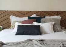 Slim-space-above-the-headboard-decorated-in-an-understated-fashion-77737-217x155