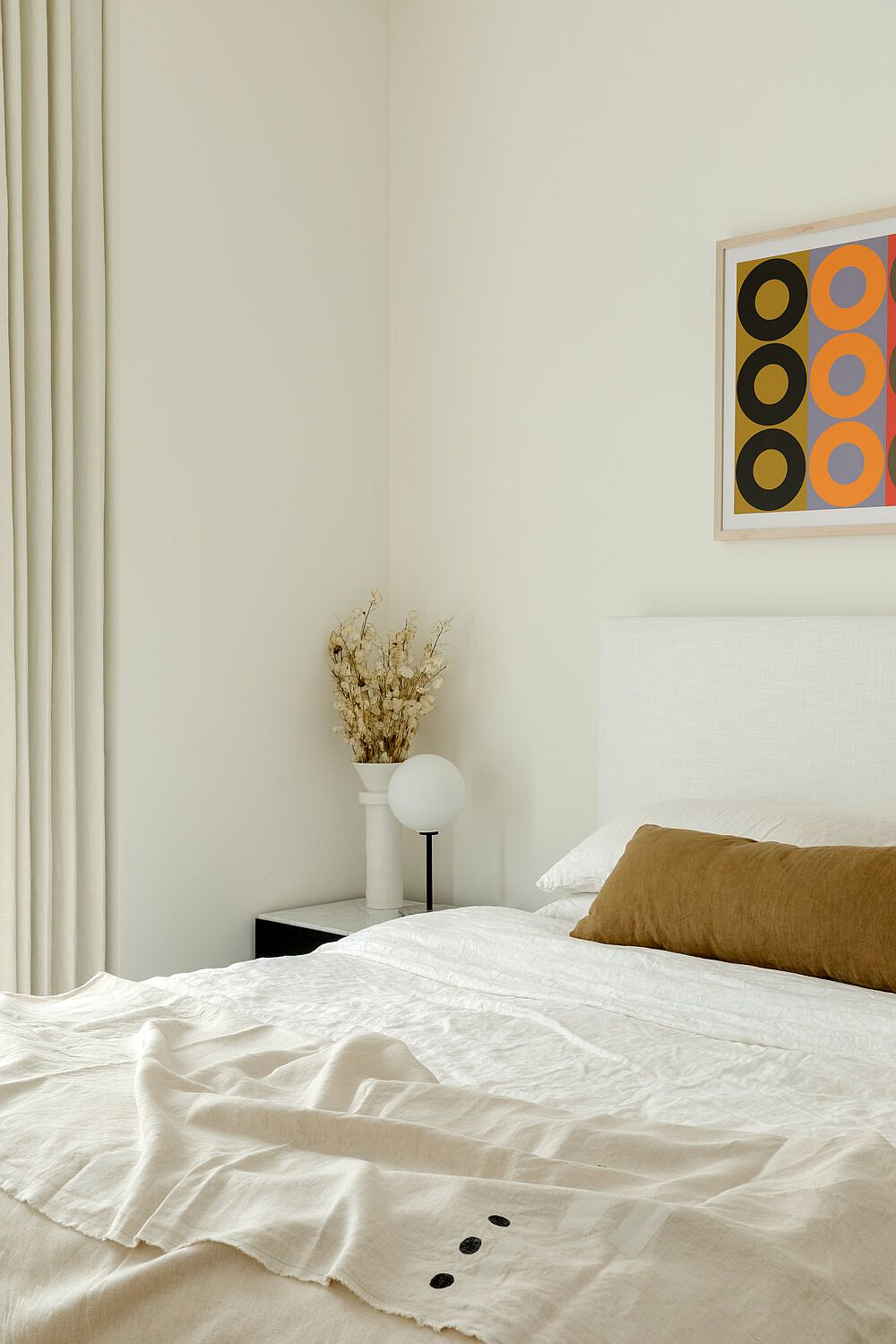 Small bedroom in white inside the modern Brooklyn apartment
