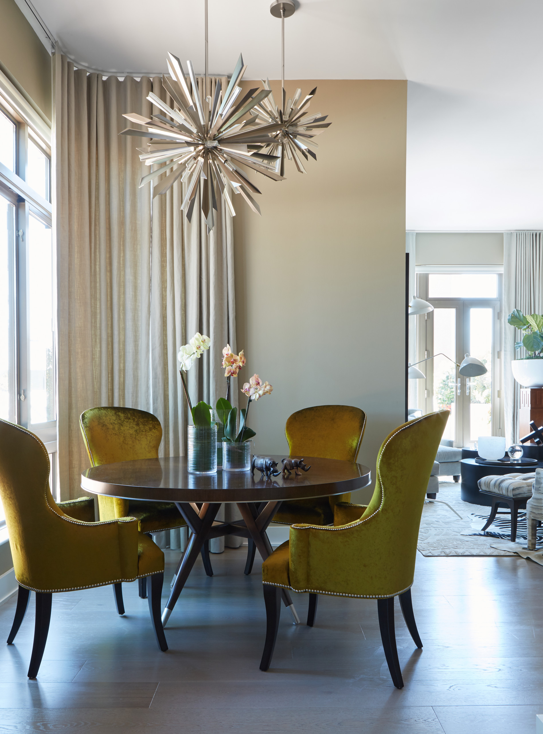 Small-contemporary-dining-room-of-NYC-condo-with-bright-yellow-green-chairs-that-add-an-air-of-luxury-16735
