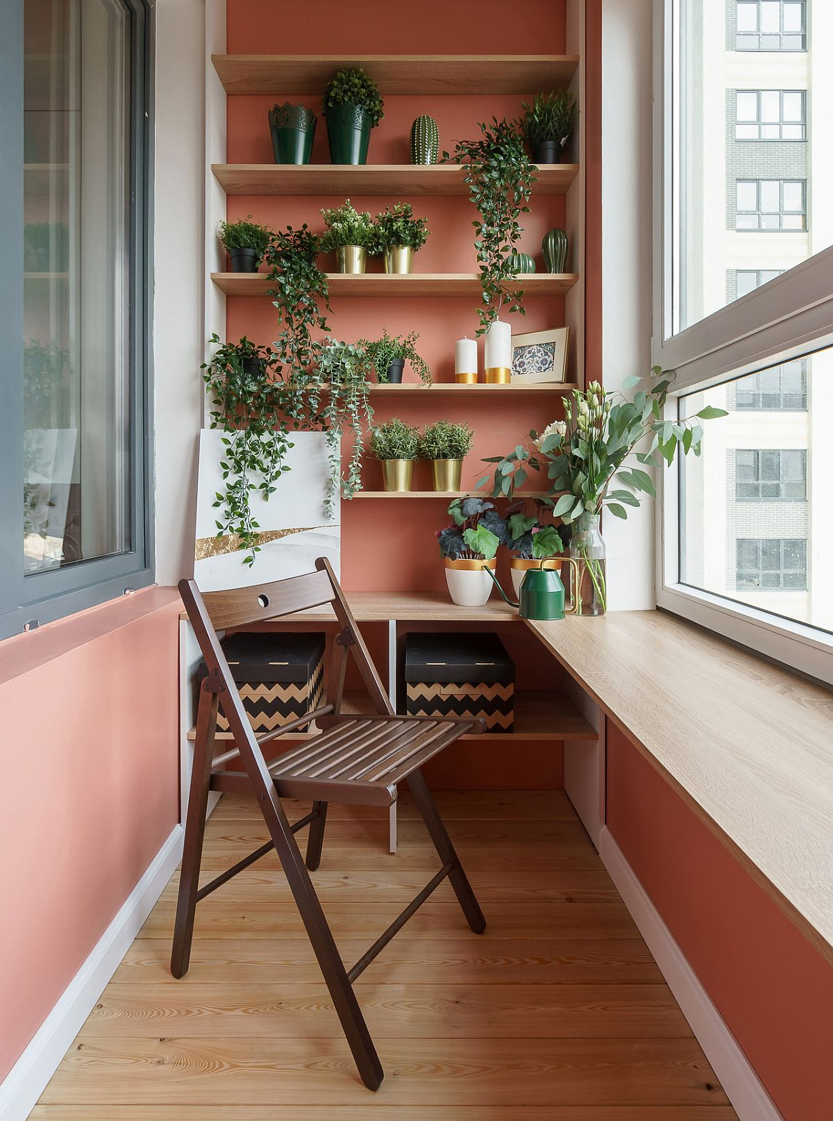 Small-contemporary-sunroom-of-Russian-home-with-pink-walls-and-a-smart-stand-to-hold-potted-plants-58155