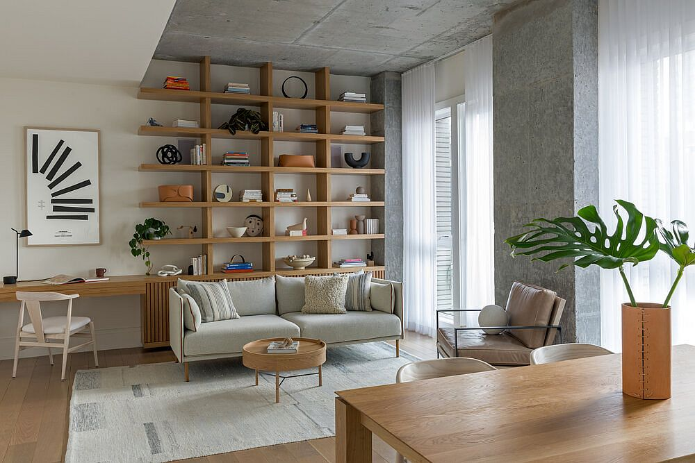 Small couch in white cleverly conceals the custom wooden cabinets behind it