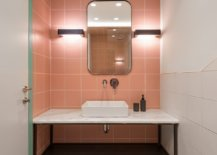 Small-modern-bathroom-with-pink-tiles-and-a-touch-of-dark-green-45367-217x155