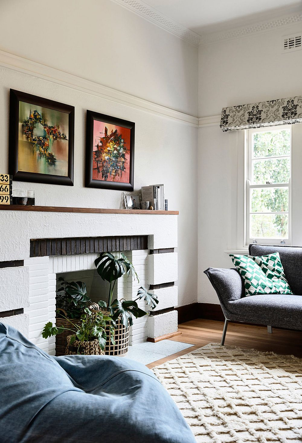 Some-of-the-original-elements-of-the-Art-Deco-home-have-been-preserved-and-enhanced-like-the-fireplace-in-the-living-room-50883