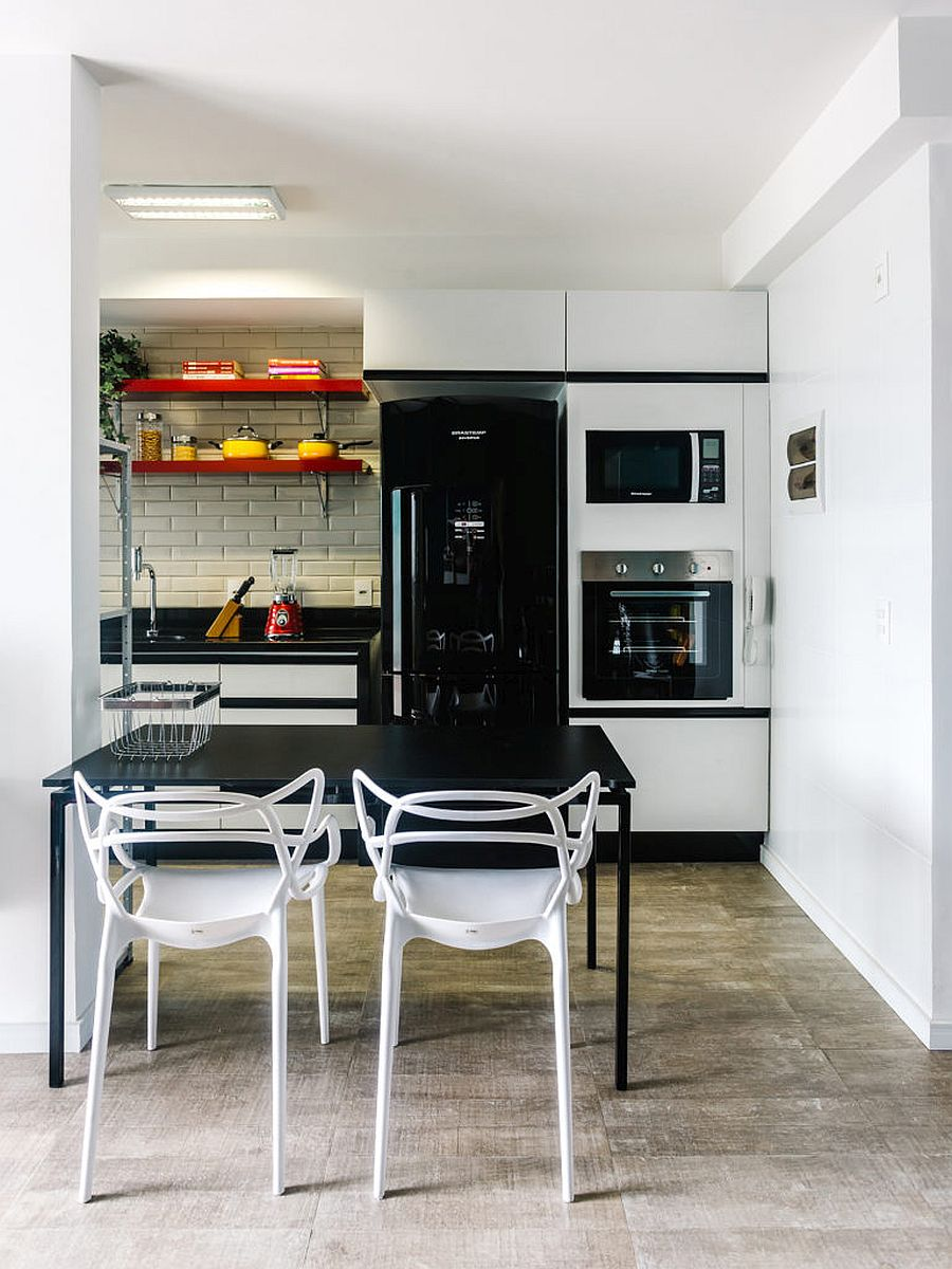 Space-savvy kitchen and dining area of the small Brazilian apartment