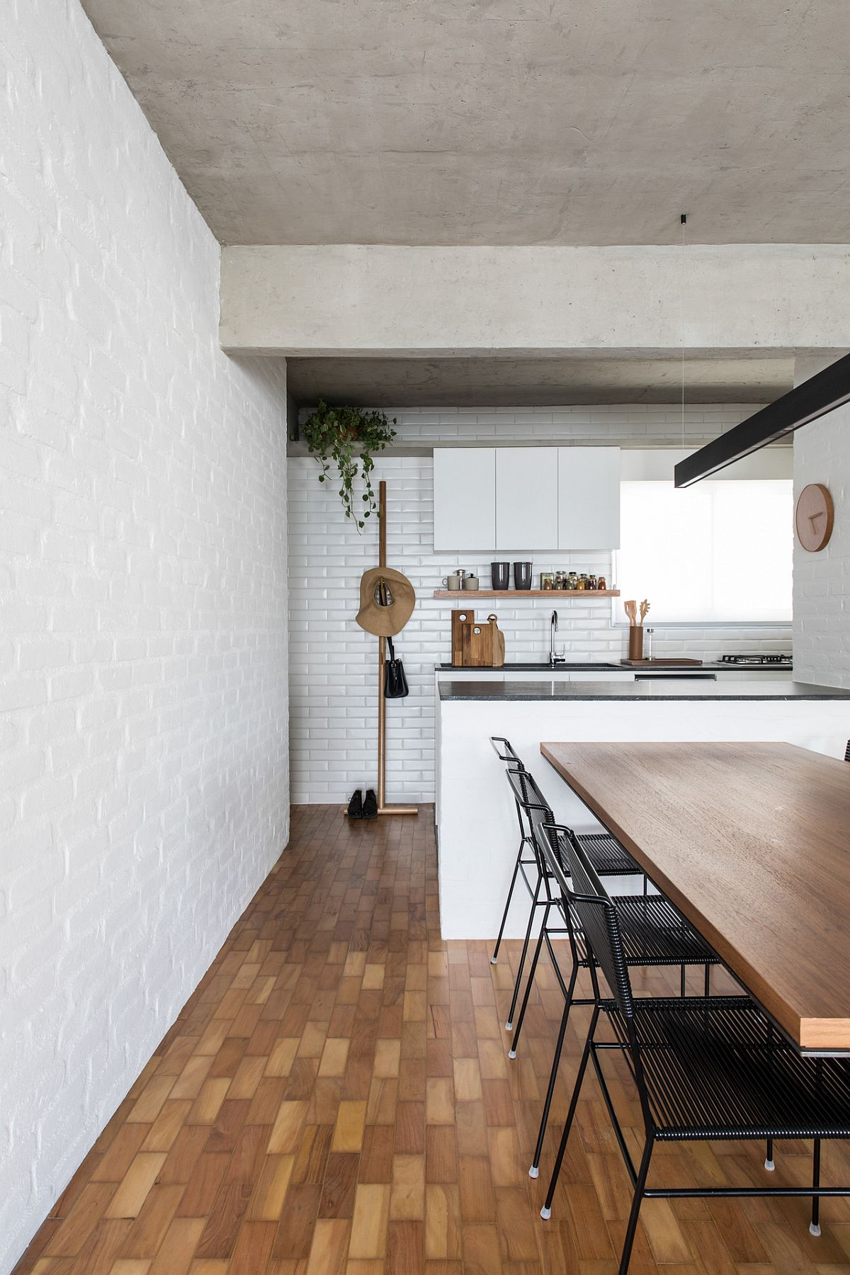 Space-savvy modern kitchen and dining room of the VCH Apartment in Sao Paulo