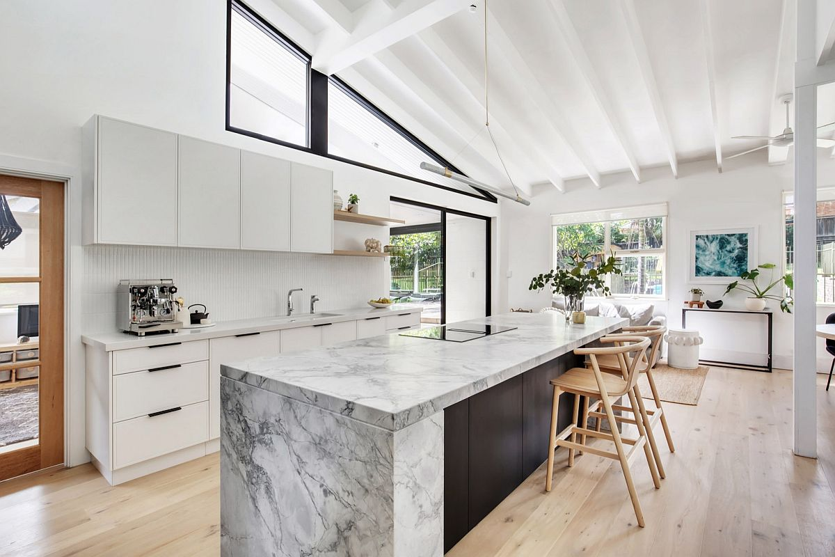 Spacious modern kitchen in white finds innovative ways to connect the interior with the outdoors