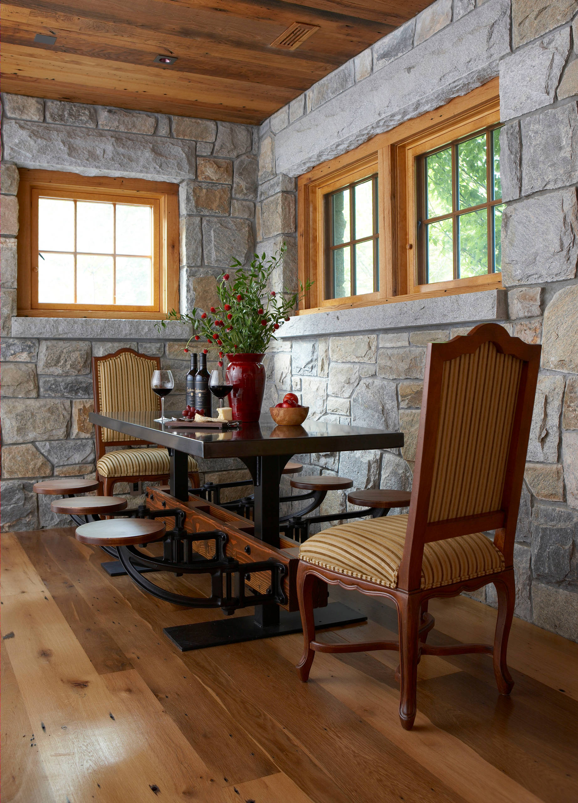 Stone-walls-and-wooden-ceiling-give-thi-New-York-home-dining-room-a-more-classical-appeal-76356