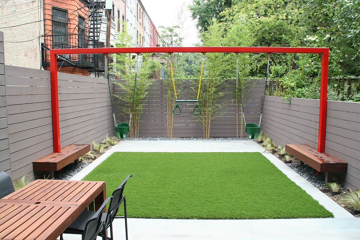 Swings add a sense of fun and excitement to this small urban backyard
