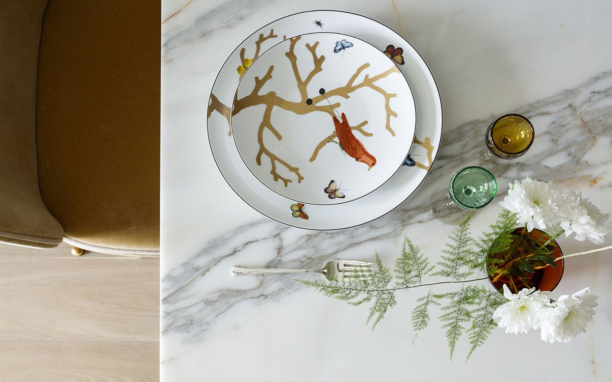 Tableware and vases bring nature-inspired prints to this contemporary dining table
