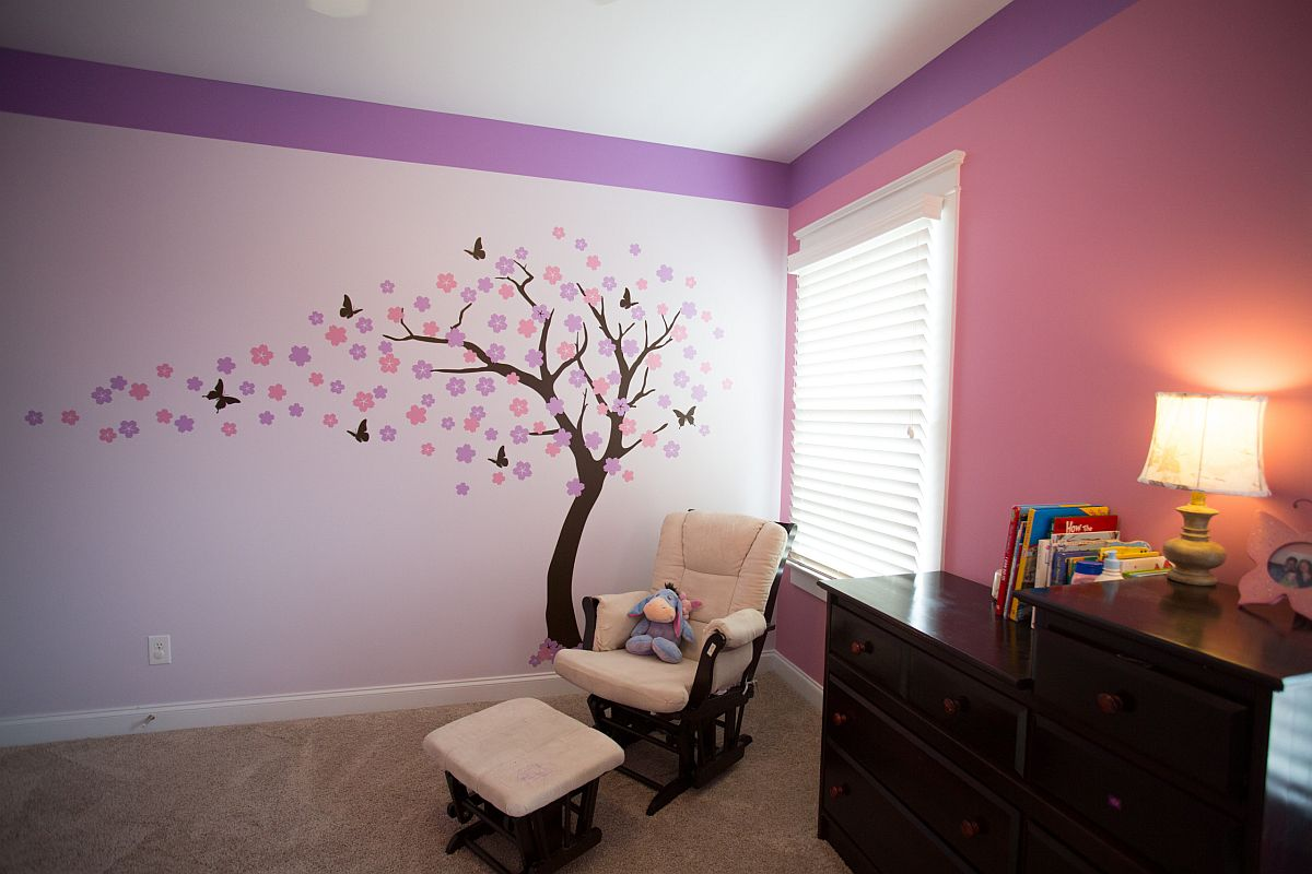 Transitional-nursery-combines-pink-and-violet-with-a-beautiful-tree-decal-91939