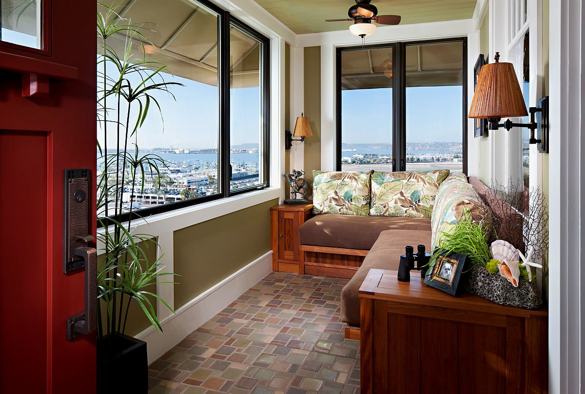 Tropical sunroom with custom built-in seating that also provides ample storage