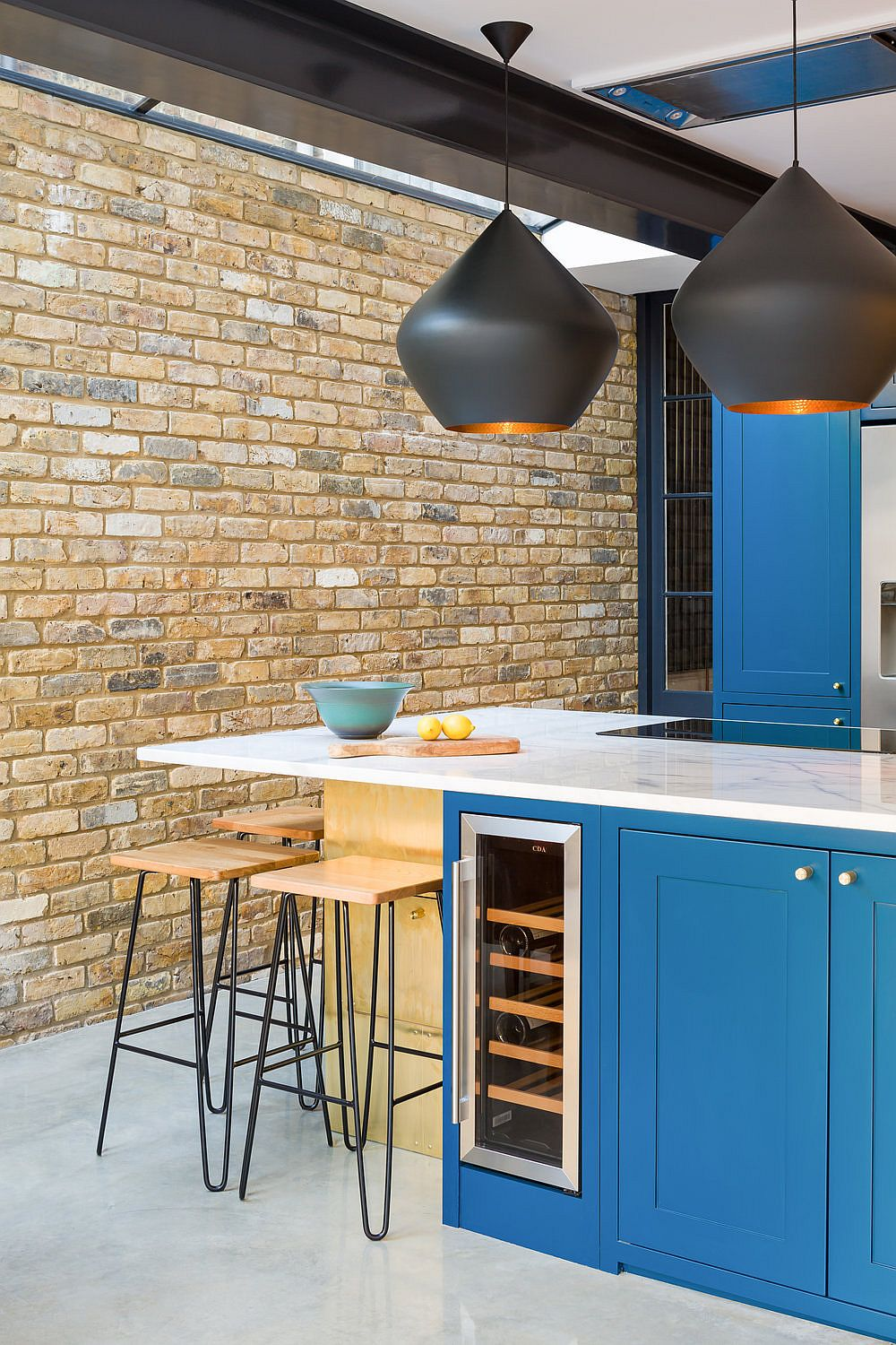 Tuck those slim bar stools under the breakfast bar to save space in the kitchen