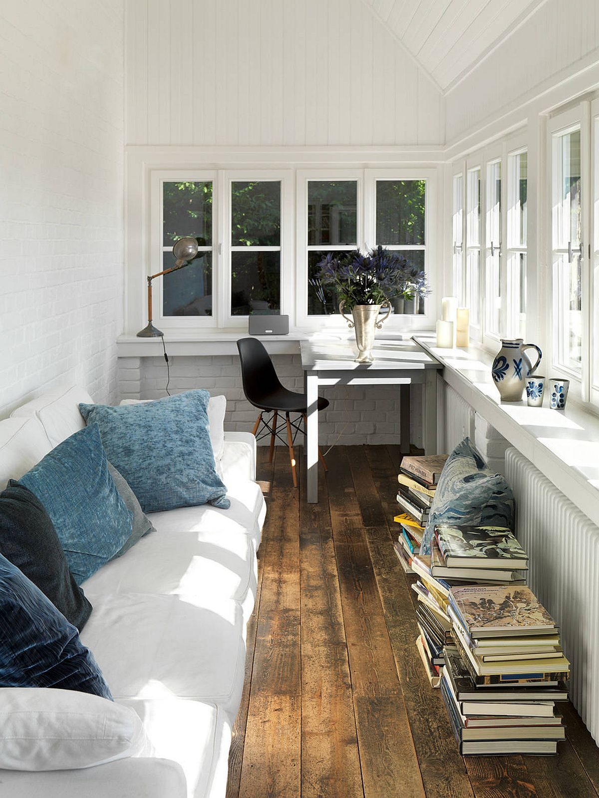 Turn the lovely modern farmhouse style sunroom into a place to work and relax