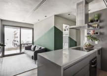 Use-of-green-along-with-burnt-cement-creates-a-modern-industrial-style-in-the-chic-Sao-Paulo-Apartment-87451-217x155