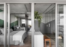 Walk-in-wardrobe-and-bedroom-of-the-small-contemporary-apartment-in-Sao-Paulo-98886-217x155