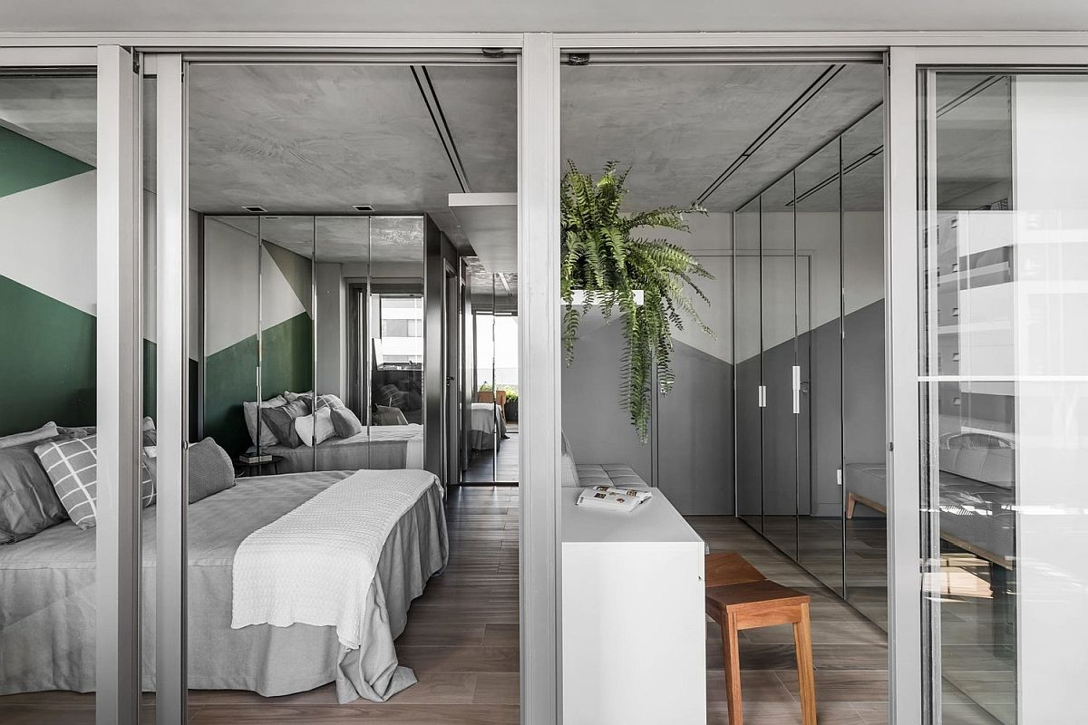Walk-in-wardrobe-and-bedroom-of-the-small-contemporary-apartment-in-Sao-Paulo-98886