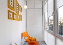 Wall-art-frames-and-chairs-bring-pops-of-orange-to-this-small-contemporary-sunroom-81291-217x155