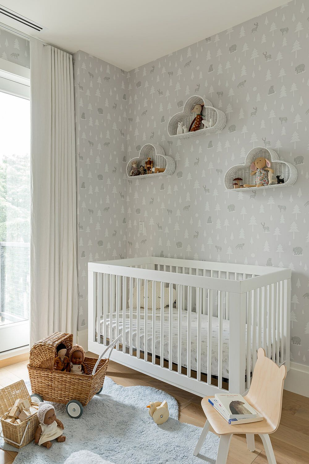 Wallpaper brings pattern to this contemporary nursery without altering its color scheme