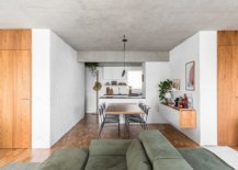 White-subway-tiled-backdrop-of-the-kitchen-allows-it-to-blend-in-with-the-white-painted-brick-walls-of-the-apartment-54804-217x155