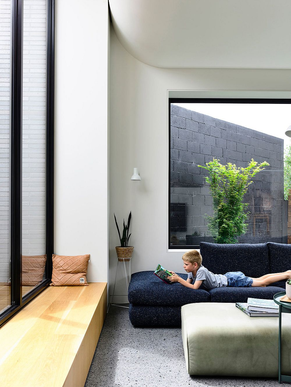 Window-seats-and-large-windows-connect-the-new-interior-seamless-with-the-outdoors-43635