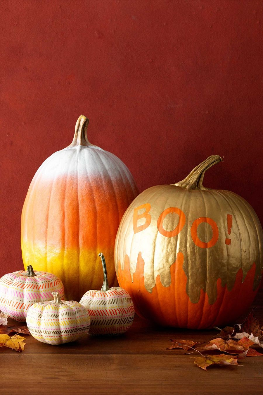 Add a touch of golden sparkle to the Halloween pumpkin with paint