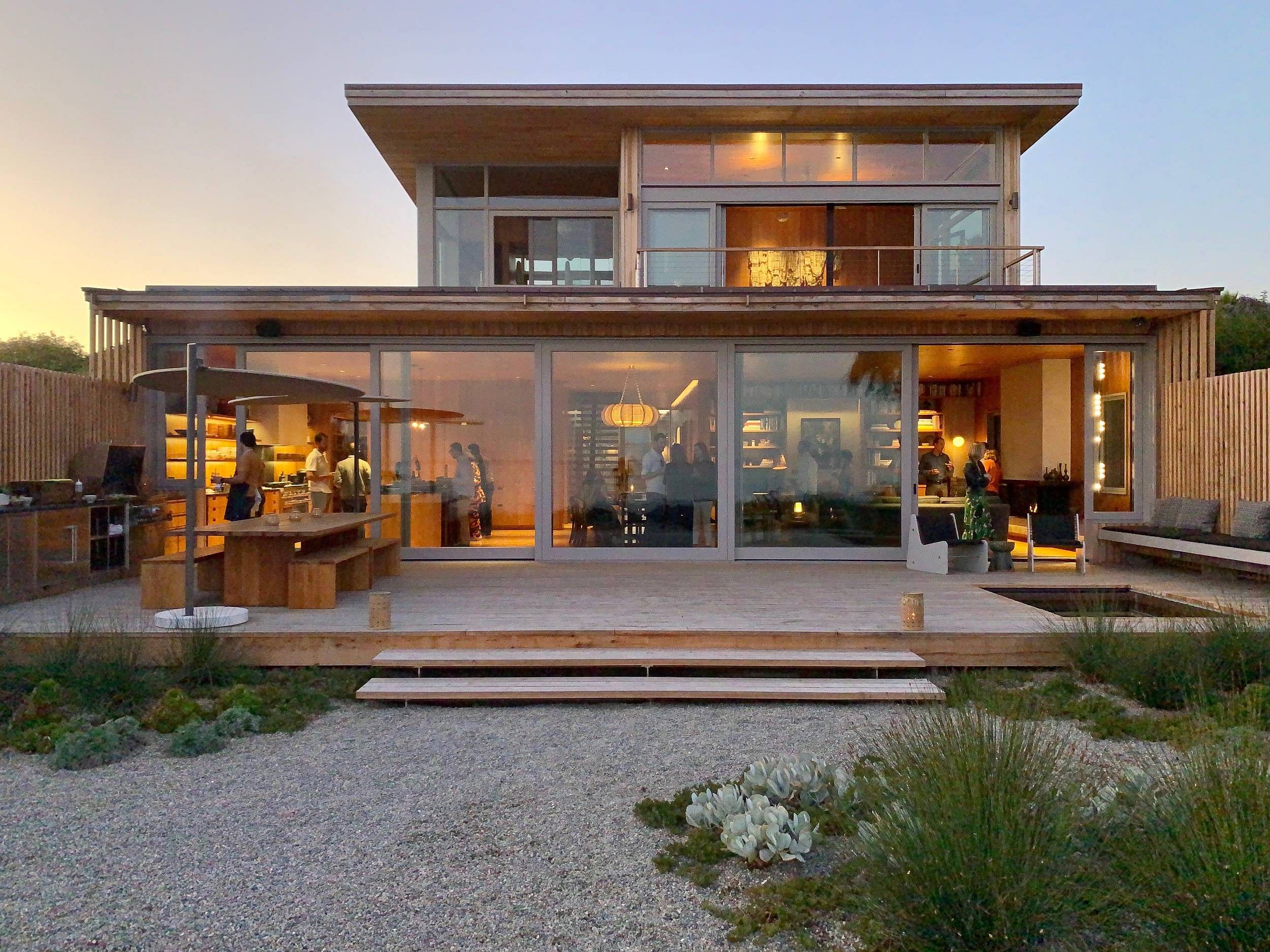Beautiful rear section of the house with sliding glass doors brings the beach and ocean indoors