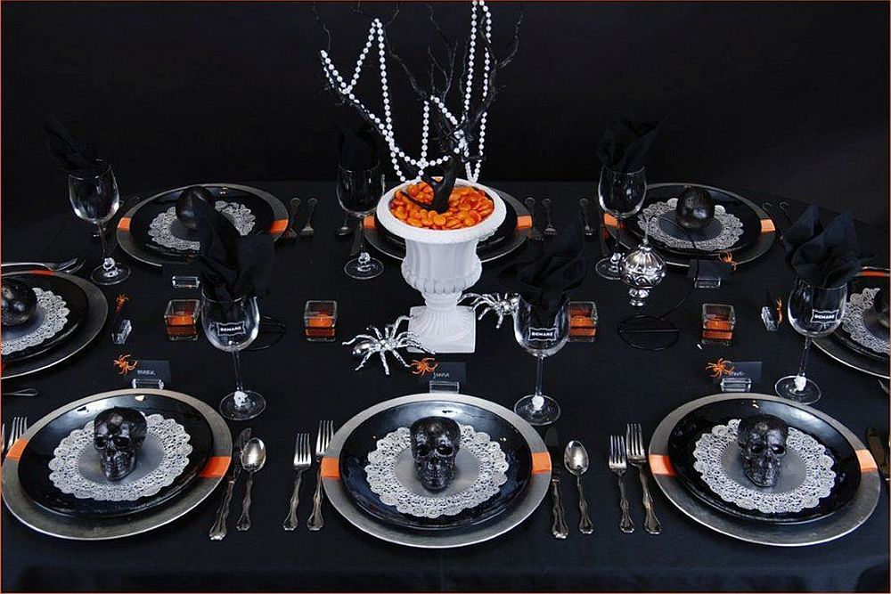 Black and orange table setting for a spooky Halloween dinner party