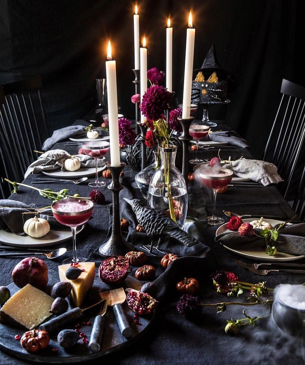 Black as a color never disappoints when you start using it for the Halloween-themed dining table