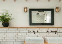 Brass-fitting-skylight-and-custom-vanity-for-the-new-bathroom-inside-the-London-home-26759-217x155