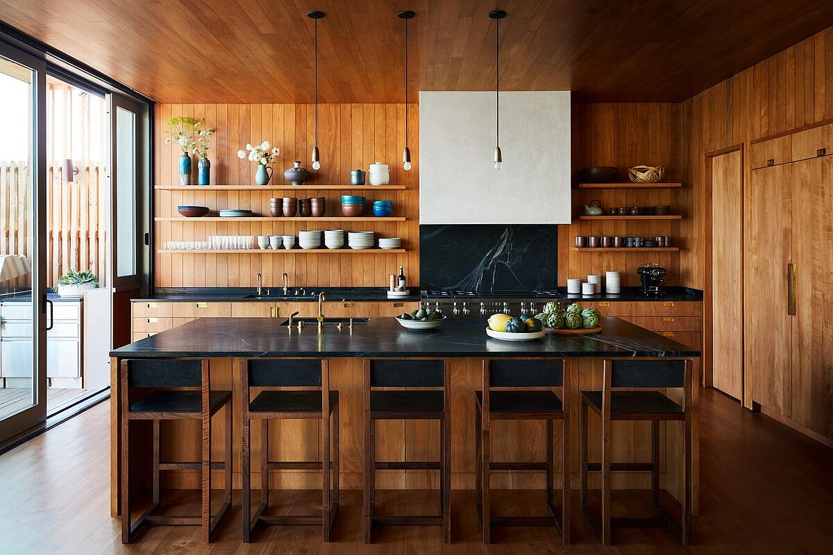 Break the monotony in the kitchen with a tone countertop and backsplash in dark stone