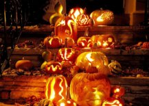 Carved-pumpkins-Jack-o-lanterns-and-fall-leaves-are-combined-to-welcome-you-at-this-house-64267-217x155