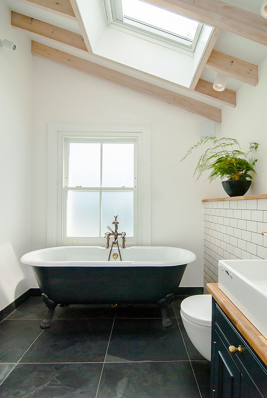 Clawfoot-bathtub-inside-the-renovated-modern-bathroom-in-white-and-black-46405