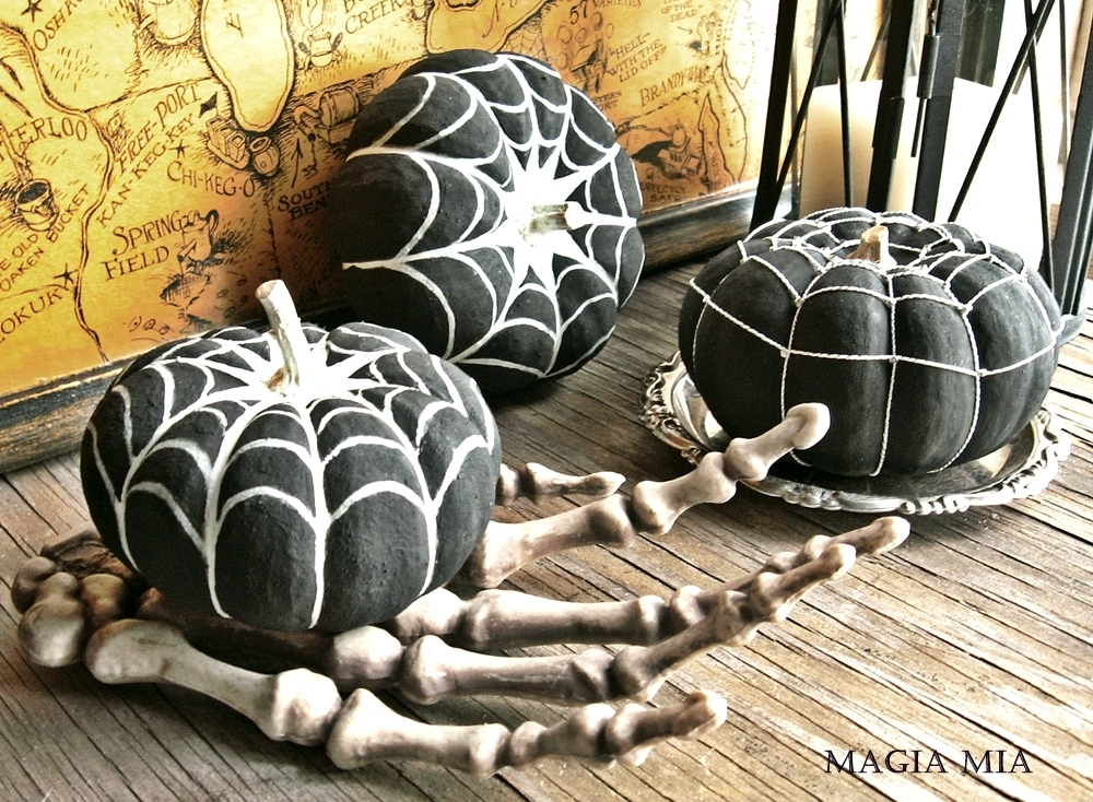 Combine the painted pumpins with spooky decorative pieces for a fun Halloween centerpiece