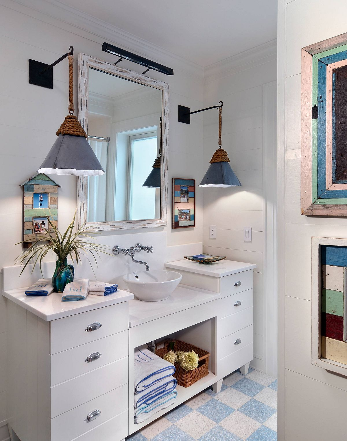 Cottage and beach styles rolled into one inside the small bathroom
