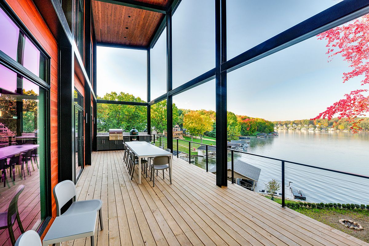 Covered lakeside deck with outdoor kitchen and ample space is the perfect place for an amazing Thanksgiving dinner