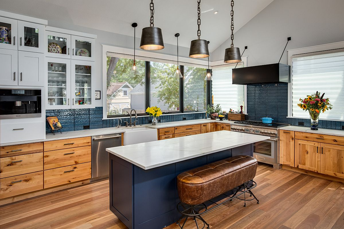 Dark bluish gray is a popular color in the modern farmhouse kitchen with wooden floors and cabinets