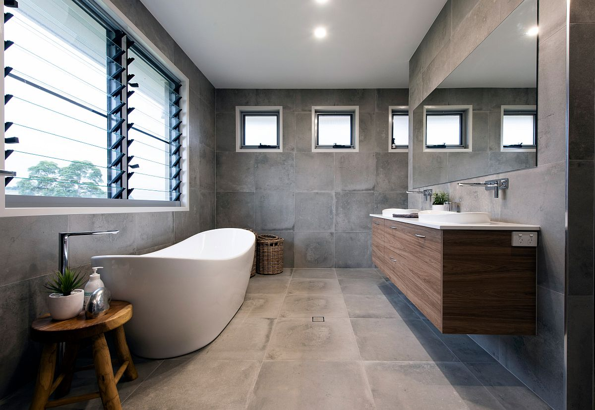 Dashing contemporary bathroom in gray with a white freestanding bathtub
