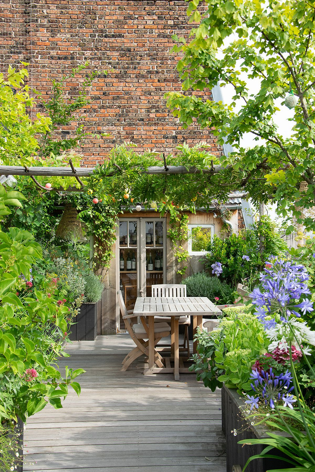 Delightful deck of Paris home with small dining space and a captivating space all around