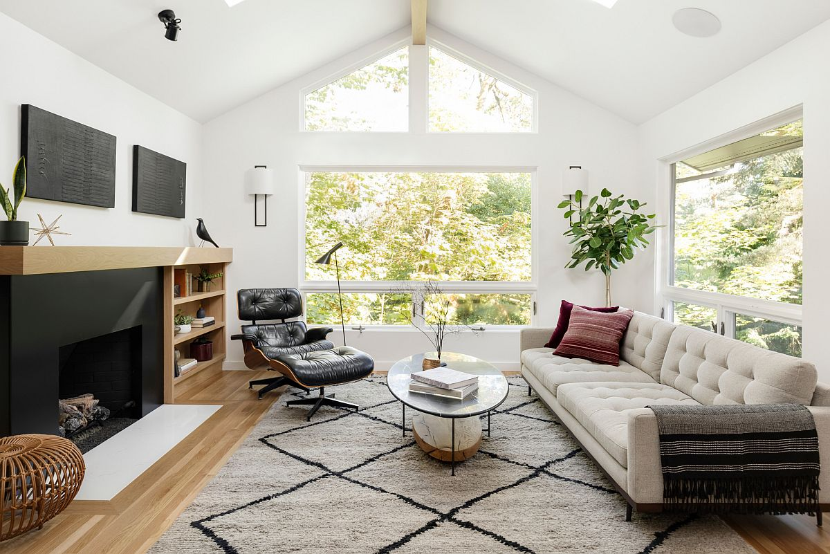 Eames lounger adds style and timelessness to the smart modern living space in white and wood with ample natural light