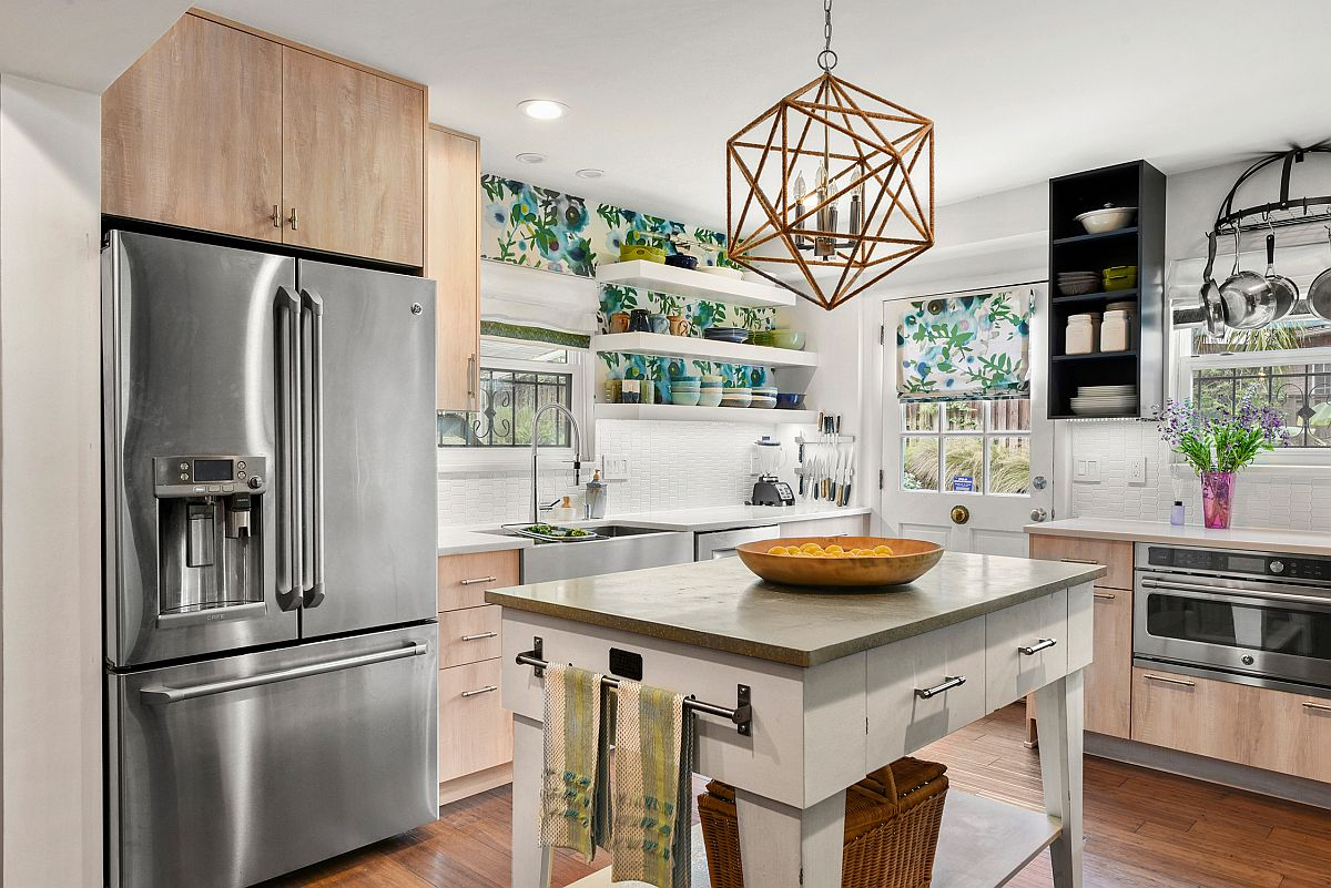 Elegant central island inside the small eclectic kitchen with an open design and a couple of drawers