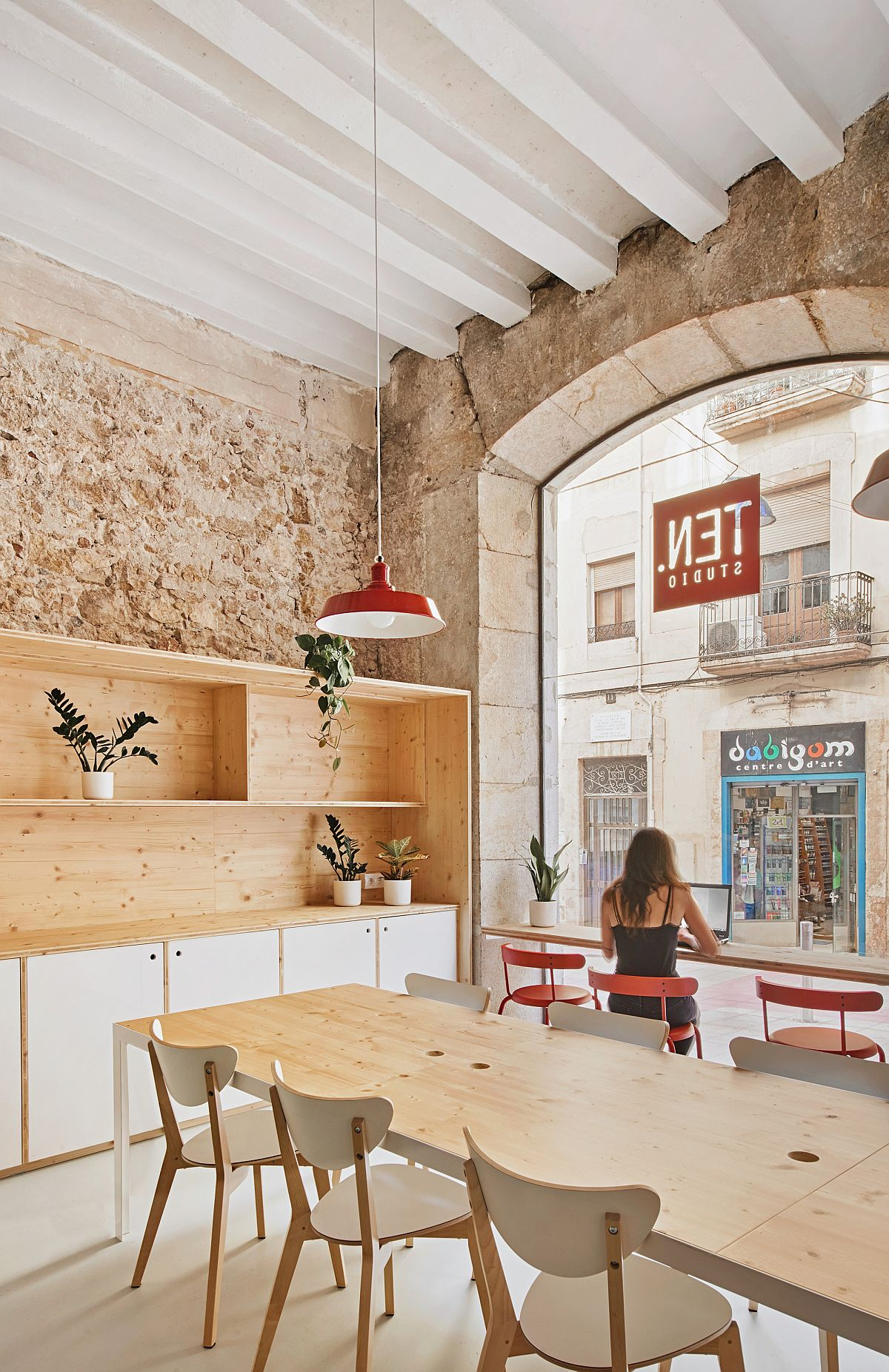 Exposed stone, brick and high ceilings give this office in Spain a unique interior